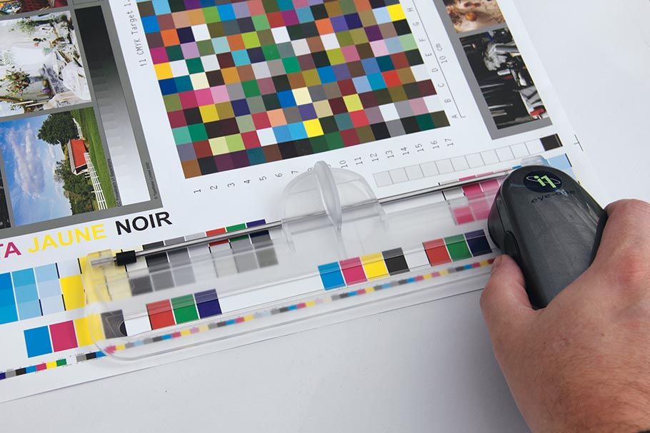 Measuring the CMYK test chart for computing the optimal CMYK print densities with CMYK_100% application